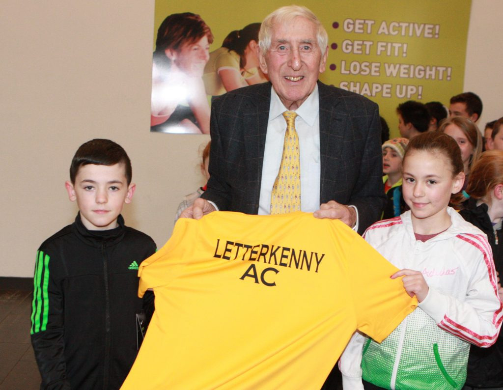 Jack and Emma Prics making a presentation to Olympic Gold Medalist in the 1956 games Ronnie Delaney
